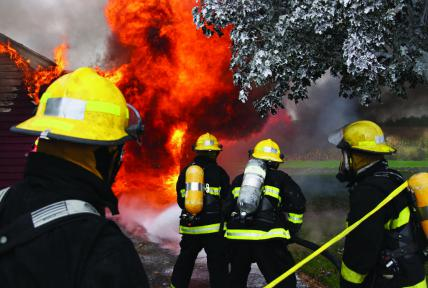 Uniformed Public Services Fireman In Action