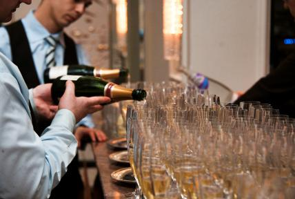 Champagne being poured into Glasses at Specialised Chef Graduation
