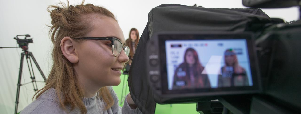 Media student in green screen room