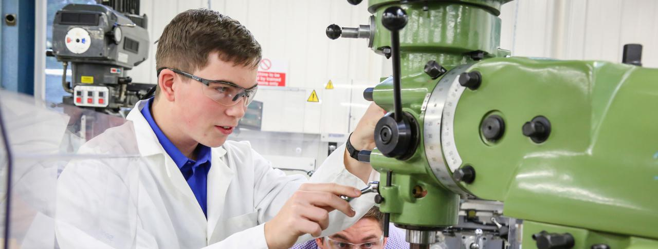 Engineering Student with Machine at Bournemouth & Poole college