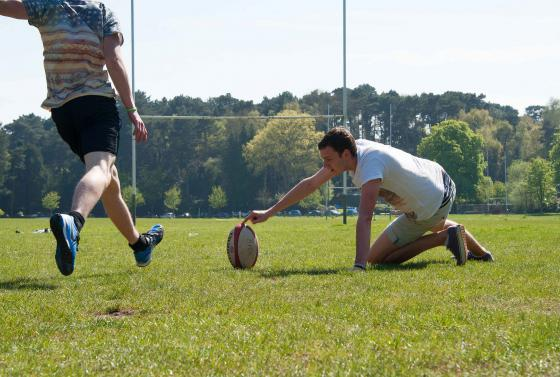 Kicking of Rugby ball Sports Students