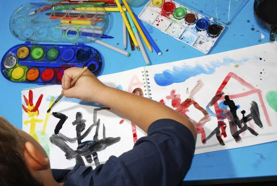 Child in classroom painting