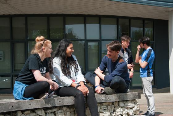 Students sat outside talking