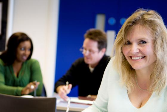 Adult learners in a classroom at Bournemouth & Poole College