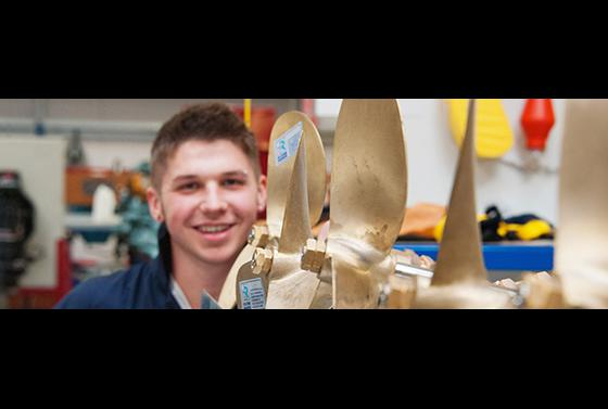 Marine engineering student with propellers