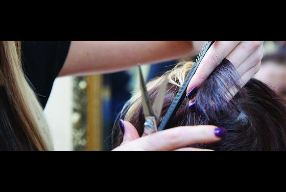 Adult learner cutting hair as part of hairdressing course at The Bournemouth and Poole College