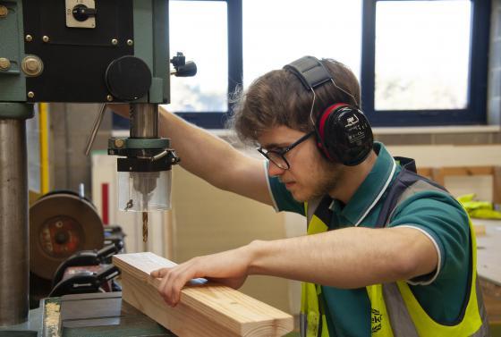 Student using woodwork machine