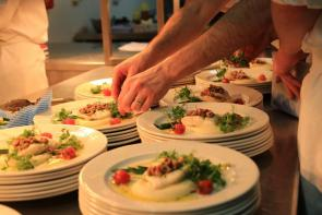 Plating up food at charity event