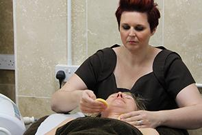 Beauty student conducting a treatment