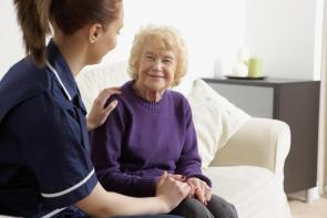 Care worker with elderly patient