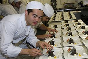 Catering students making dessert in Escoffier