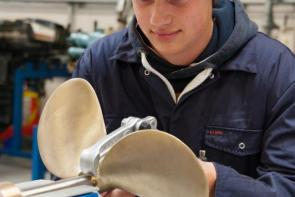 College student working with propeller