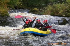 College students water rafting