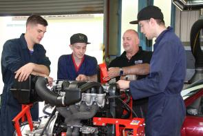 motor students working on an engine