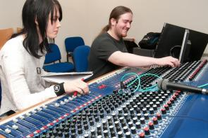 Music students using a soundboard