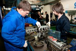 'motor students working on an engine