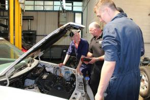 Motor Vehicle students inspecting a car engine