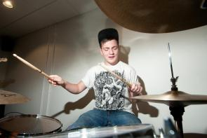 Music student playing the drums