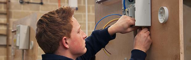 Electrical student wiring a prototype
