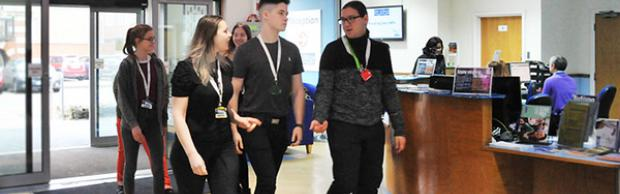 Student in reception area at Bournemouth & Poole College
