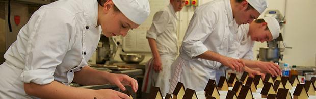 Student chefs creating desserts in Escoffier
