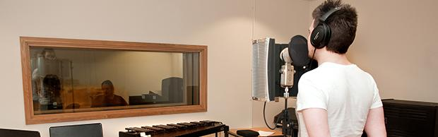 Music student recording a song