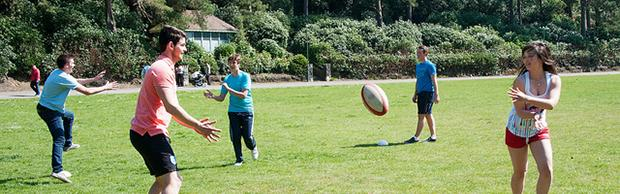 Students playing rugby at Bournemouth Gardens