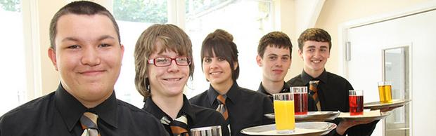 Students serving customers at the Coastline Brasserie